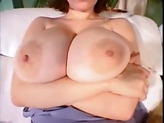 nicole plays with her boobs on the sofa