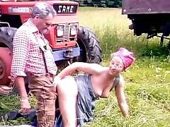 Grandpa and niece in the field
