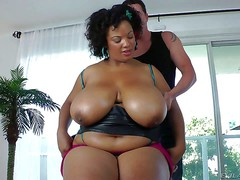 Thick ebony lady Betty Blac with natural monster tits gets