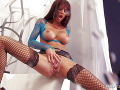 Gia Dimarco is a horny woman with long legs and