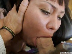 Exotic looking brunette Monica C gets her mouth stretched by