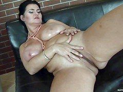 Big breasted chubby brunette Reny exposes her meaty pussy and