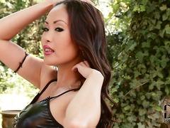 Asian bombshell Danika in black leather mini skirt and top