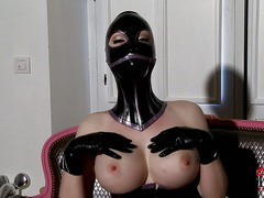 Latex Lucy is a fetish model she wears black mask,