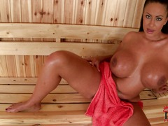 Brunette Emma Butt is alone in the sauna showing off