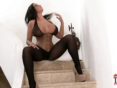 Big boobed Emma Butt in tight corset shows off her