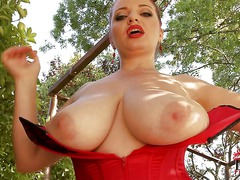 Curvy redhead Joanna Bliss dressed in red shows off her