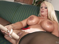 Blonde Alura Jenson with monster tits gives a close-up view