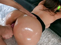 Hot brunette MILF Raylene gets her big oiled tattooed ass
