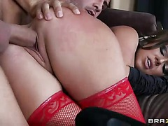 Tattooed dark-haired witch Julia Bond in red stockings and black