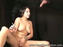 Tattoed and pieced girl smoking handjob