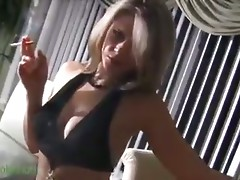 Smoking blonde dancing and teasing