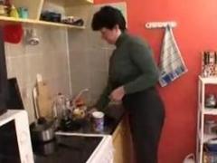 Mom and boyfriend in kitchen