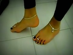 Hot girl dangle her feet with flip flop