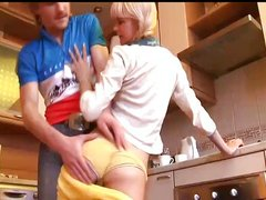 Loly Cute blonde gives blowjob at kitchen