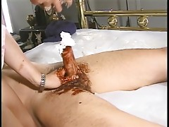 Playful blonde covers dude's cock with whipped cream and syrup then rubs it off