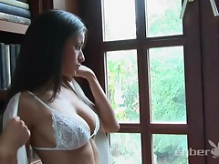 Seductive babe Jo Garcia gets naked in the library