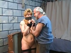 Thick blonde torture victim is restrained before her breasts are roped up