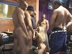 Smoking hot Taylor Lynn gets surrounded by about ten cocks