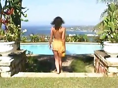 Poolside solo action with a busty model Alicia Burley