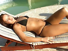 Two smoking hot babes are having an oral sex on the poolside