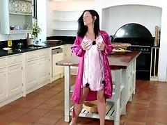 Insanely hot brunette masturbates in the kitchen