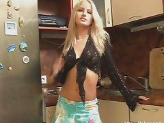 Sexy blonde Alma shows herself naked in the kitchen.