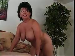 Voluptuous milf strokes and sucks a cock