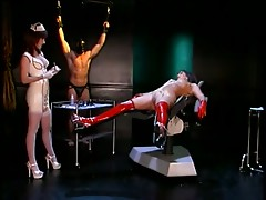 Dominatrix nurse sticks dildo up brunettes tight pussy