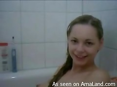 Nasty German girl masturbates with a toothbrush in the tub