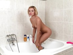 Smoking hot blonde is having fun with shower head