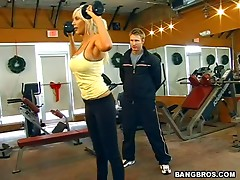 Nasty trainer fucks a bosomy blonde milf in the gym
