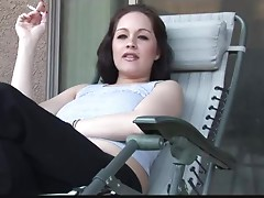 Foxy Brunette Girl Talking Dirty while Smoking Outdoors