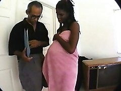 Pregnant ebony girl tickles his cock and gets a tit fuck