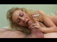 Smoking Granny sucks a fat cock