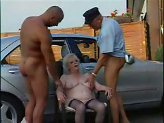 Granny in Stockings Plays with Two Cocks