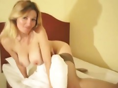 Mature housewife shows off her body and touches her body