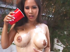 Asian sex goddess Jessica Bangkok covers her curvy body with oil