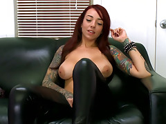 Punky Mila Treasure poses in leather pants and sucks a dildo